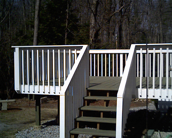 Green Le Deck With White Railing